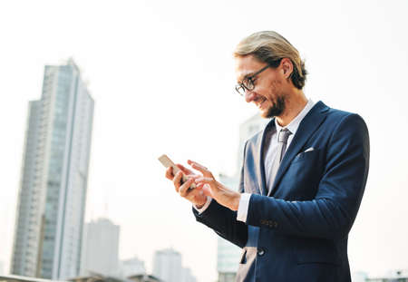 coffee breaks: Businessman Working Connecting Smart Phone Concept