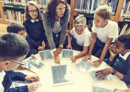 early childhood: School Teacher Teaching Students Learning Concept Stock Photo