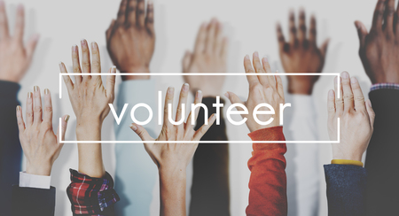 Raised hands with volunteer concept