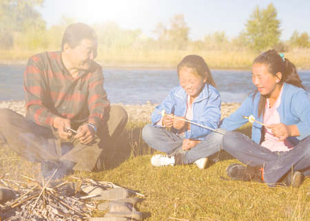 independent mongolia: Mongolian Family Anjoy Camping by The River Concept