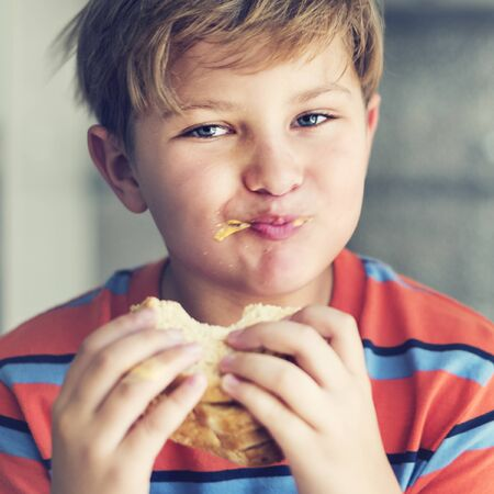 starving: Boy Child Kid Bread Sandwich Starving Eating Concept Stock Photo