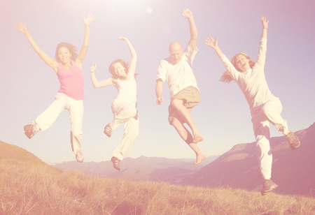 happines: Group of People Jumping Happines Outdoors Concept Stock Photo
