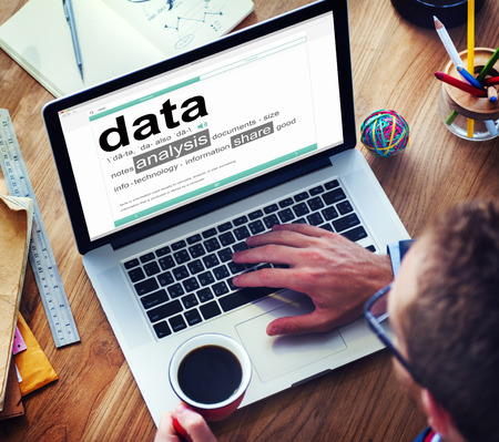 metadata: Man Reading the Definition of Data Stock Photo