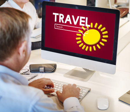 Businessman using computer with travel internet search