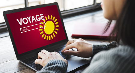 Woman using a laptop with voyage internet search