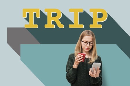 Woman using a smartphone with trip concept Stock Photo