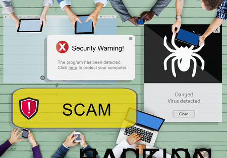 People using digital devices with scam alert