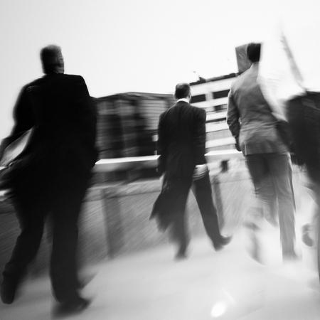 mundane: Businessmen walking to their workplace.