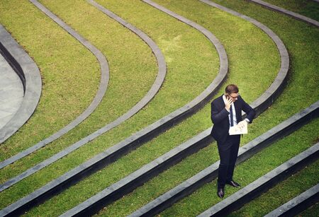 retardation: Business Man Check Time Outdoors Concept Stock Photo