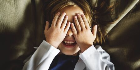 seek: Kid Playing Hide Seek Smiling Concept Stock Photo