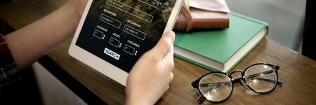 lugage: Tablet Searching Flight Travel Booking Concept Stock Photo