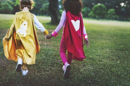 schooler: Superheroes Kids Friends Playing Togetherness Fun Concept