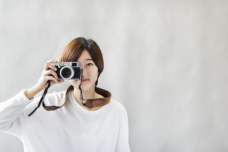 Aziatische meisje Camera Fotograaf Focus Concept Shooting Stockfoto - 59277453