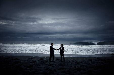 creative strength: Business Handshake on the Beach Concept Stock Photo