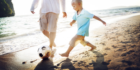 getting away from it all: Family Father Son Togetherness Football Soccer Sport Concept Stock Photo
