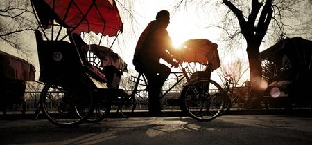 rikscha: Rikscha-Riding Tricycle Traditionelle Kultur Konzept Lizenzfreie Bilder
