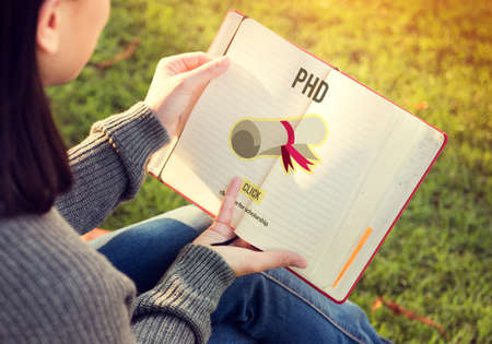PhD Doctor of Philosophy Degree Education Graduation Concept Stock Photo