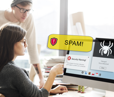Woman looking at spam from a computer Stock Photo