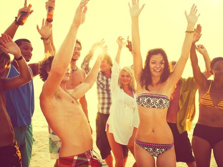 adults: Young adults having beach party in summer.