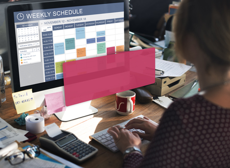 Woman at work with weekly schedule on screen