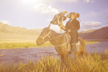 independent mongolia: Kazakh with Trained Eagle Concept Stock Photo