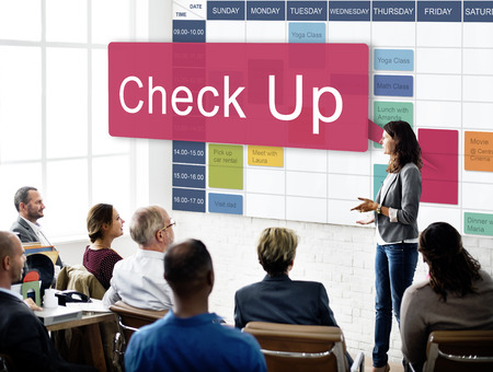People in a seminar with schedule and check up concept