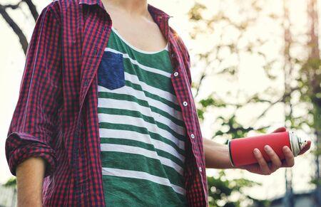Boy Holding Spray Paint Concept