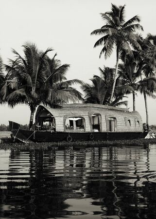 backwater: Peaceful Houseboat Travelling Backwater Concept