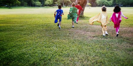 superheroes: Superheroes Kids Friends Playing Togetherness Fun Concept