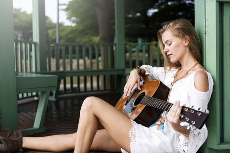 hippie woman: Hippie Woman Playing Music Concept