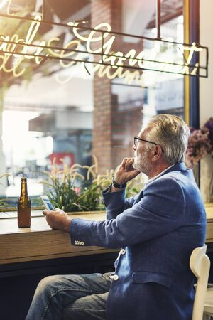 casual men: Senior Man Hangout Drinking Alcohol Night Club Concept