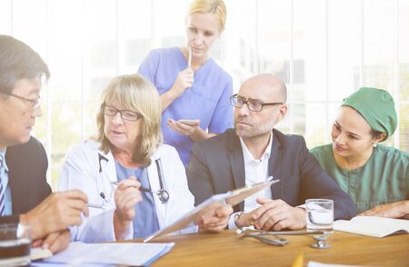 healthcare workers: Healthcare Workers Having a Meeting Stock Photo