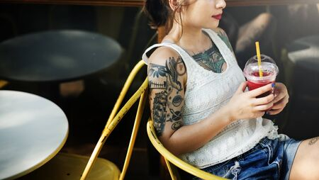 tattoed: Tattoed Woman Chilling Cafe Concept