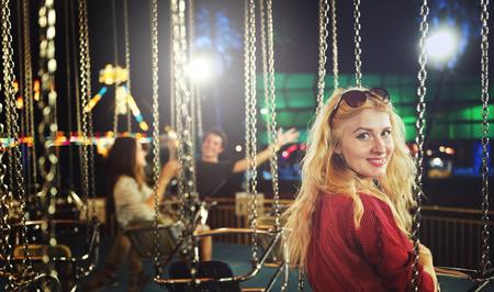 carnival ride: Woman Carnival Ride Happiness Fun Concept Stock Photo