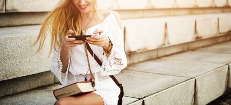 Woman Girl Sitting Texting Smiling Concept Stock Photo