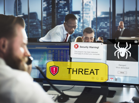 Businessmen with computer virus threat concept Stock Photo