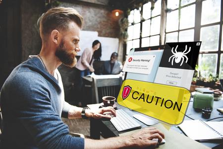 Businessmen with computer virus caution concept
