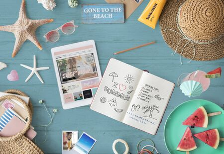 opened bag: Digital Tablet with book and beach travel concept
