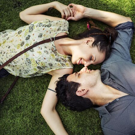 laying down: Laying Down Couple Destiny Relationship Relax Concept Stock Photo