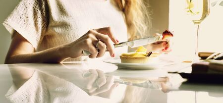 mingle: Woman Eating Dessert Chill Relax Concept Stock Photo
