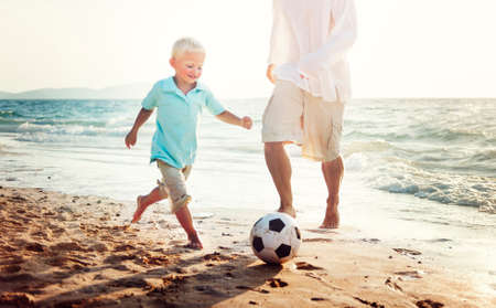 away from it all: Family Football Playful Father Son Togetherness Concept