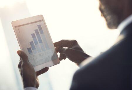 summarize: Businessman Looking Statistics Analytics Concept