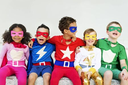 schooler: Superheroes Kids Friends Playing Togetherness Concept Stock Photo