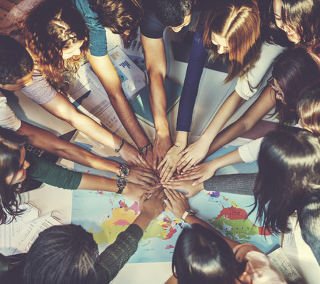 clasped hand: People Friendship Brainstorming Hand Clasped Teamwork Concept Stock Photo