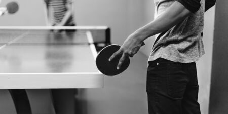 tabletennis: Two Friends Playing Tabletennis Concept