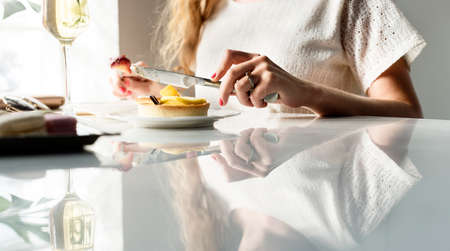 chill: Woman Eating Dessert Chill Relax Concept Stock Photo
