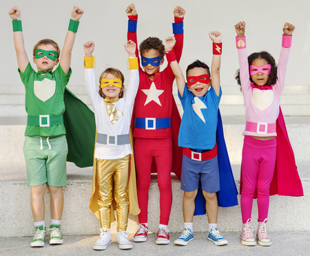 powerful: Superheroes Kids Friends Playing Togetherness Fun Concept