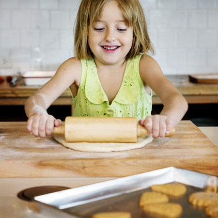 Image result for a kid cooking cookies