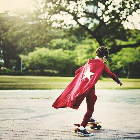 playful: Kid Skateboard Superhero Youth Playful Concept
