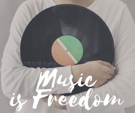 relates: Female Holding Vinyl Music Graphic Concept Stock Photo